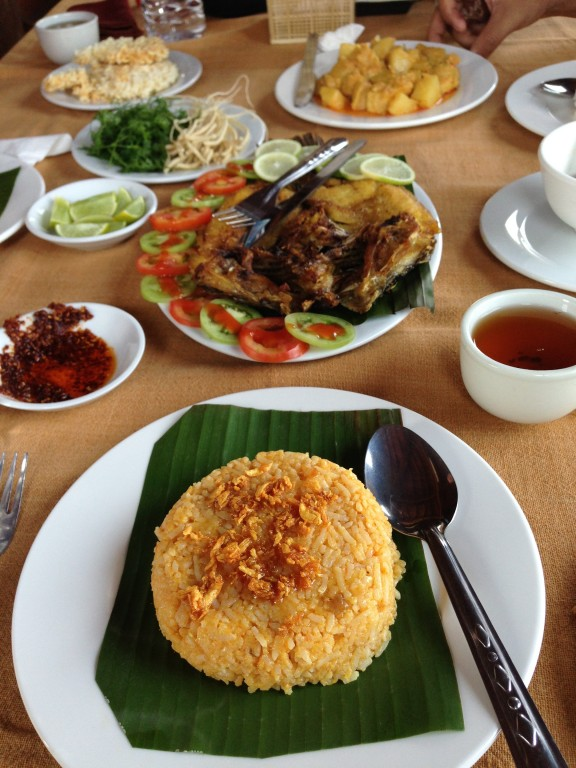 Traditional Burmese lunch at Inle Lake. Rice with toasted garlic, fish and vegetables.