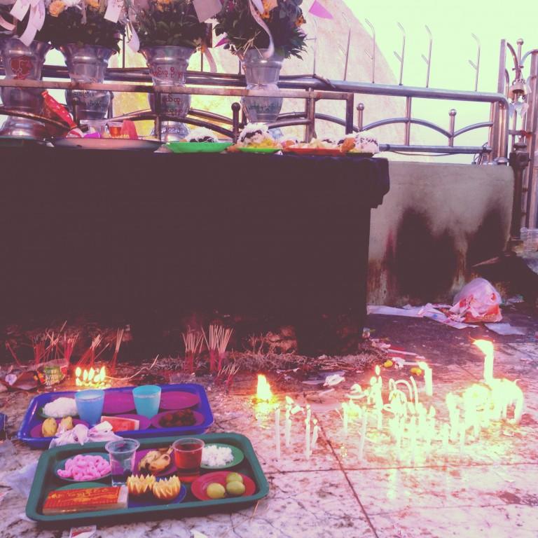 Burning offerings for Buddha, Golden Rock.