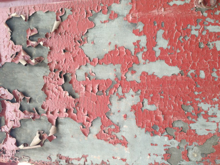 Inside the expansive walls of the Forbidden City, the red paint yields to the elements and the passing of time.