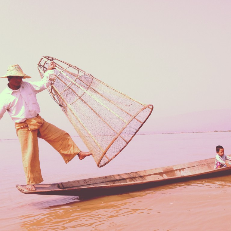 Fishing in traditional style at the entrance to Inle Lake. Word on the lake is that this is performed primarily for tourists, as they now fish with more modern gear.