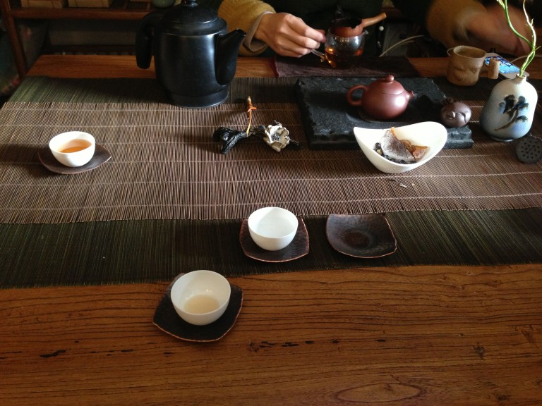 Pu-erh tea ceremony at a tiny tea shop in 798 provides respite from cold, and propels conversation.