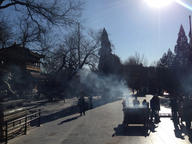 Aromatic sandalwood incense smoke fills the air at the Temple of Heaven.