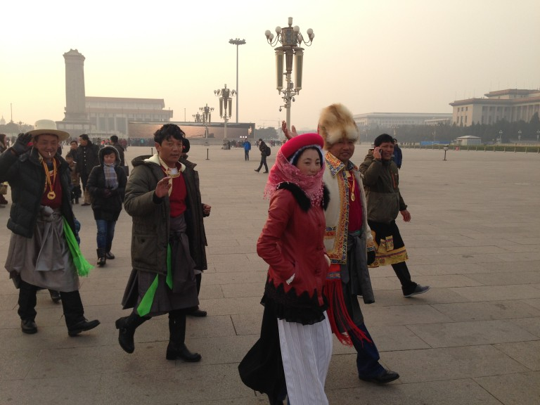 Gorgeously adorned group of Tibetan tourists in Tiananmen Square.