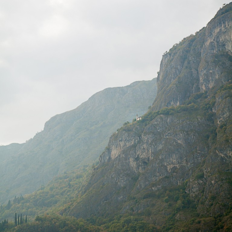 A church sits aloft on a cliff high above Menaggio
