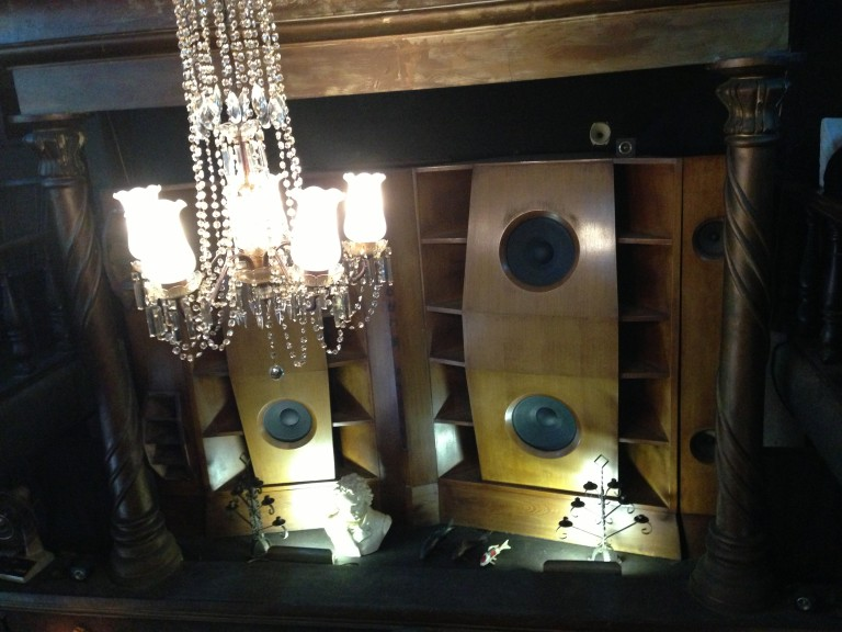 Giant floor to ceiling speakers fill Lion's Club with all classical all the time on vinyl.